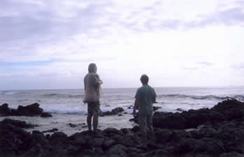 Brother Noland and John Stokes look out from Halona Point toward Moloka'i